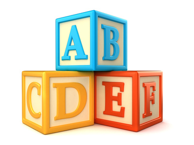 ABC building blocks on white background | Homeschooling 911